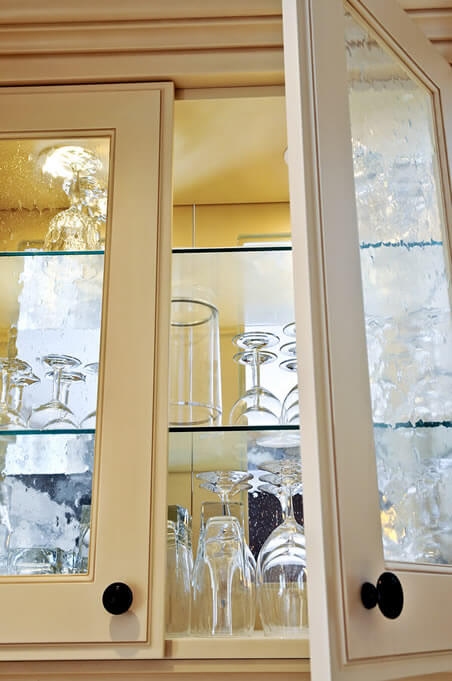 Antique Cream Cupboard Used to Showcase Glassware