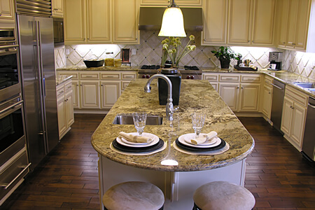 Traditional Antique White Kitchen with Cream/Fawn Granite Countertops
