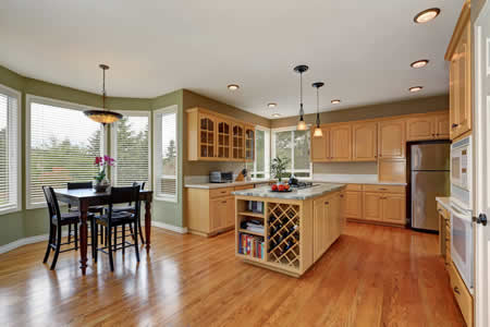 Blond Maple Kitchen with Center Island and Wine Rack