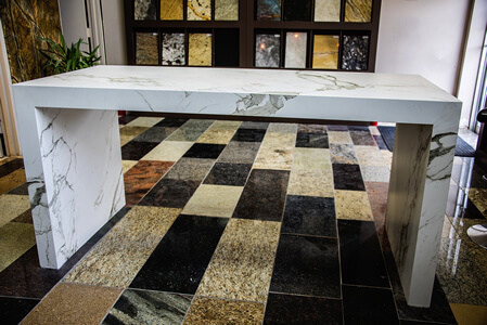 Granite Marble Showroom with Samples on Wall/Floor and Marble Table