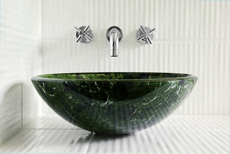 Green Bowl Sink Mounted on Corrugated White Ceramic Counter