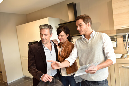 Couple Choosing Kitchen Furniture with Salesman
