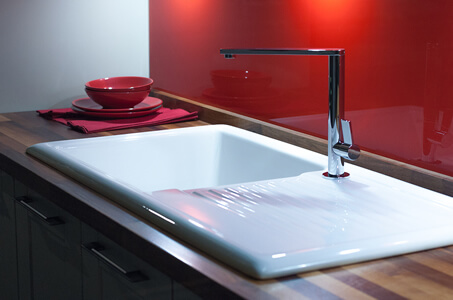 Modern Porcelain Sink and Faucet with Wooden Countertop