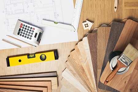 Planning a Remodel with Blueprints, Calculator, Wood Flooring Samples
