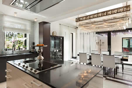 Ultra Modern White Kitchen with Black Onyx Countertop on the Center Island